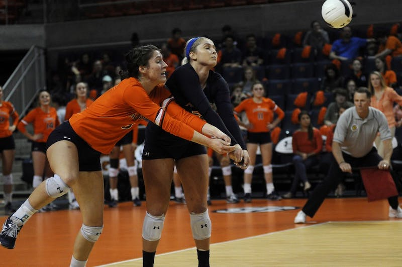Brenna McIlroy (8) and Jesse Earl (3) go for the ball during Auburn Volleyball vs. Alabama on Wednesday, Nov. 1, 2017 in Auburn, Ala.