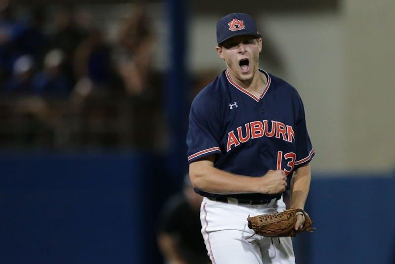 Davis Daniel (13) celebrates a strikeout during Auburn Baseball's Super Regional vs. Florida on June 11, 2018, in Gainesville, Fla.
