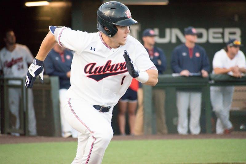 Judd Ward (1) runs toward first base at Auburn baseball vs. Samford on Tuesday, April 24, 2018, in Auburn, Ala.