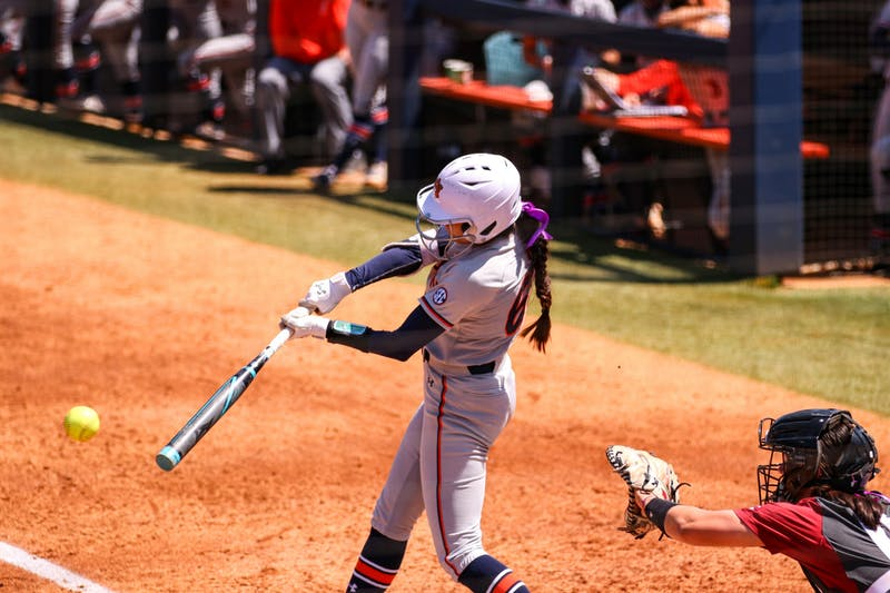 Tyler King (66) hits the ball during the game between Auburn and Arkansas at Jane B. Moore Field on April 3, 2021; Auburn, AL, USA. Photo via: Jacob Taylor/AU Athletics