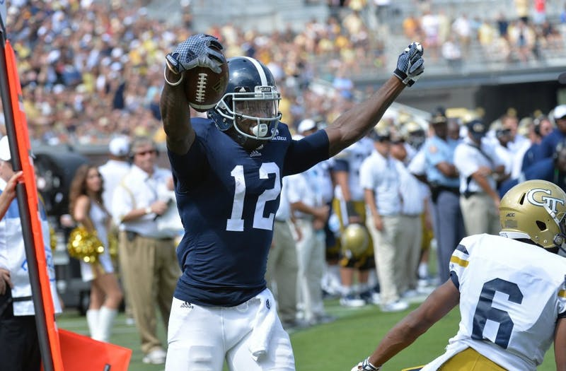 Georgia Southern Eagles wide receiver BJ Johnson (12) celebrates after he scored a touchdown against the Georgia Tech Yellow Jackets in the second half at Bobby Dodd Stadium on September, 13, 2014 in Atlanta. The Yellow Jackets beat the Eagles 42-38. (Hyosub Shin/Atlanta Journal-Constitution/MCT)