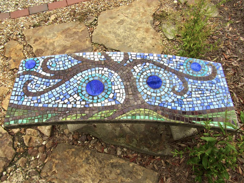 Elementary and middle school students contributed design ideas for the mosaic benches.