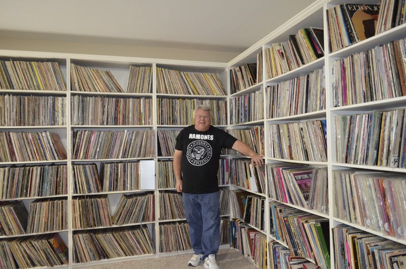 Dr. Peter Stanwick stands with his collection of records.