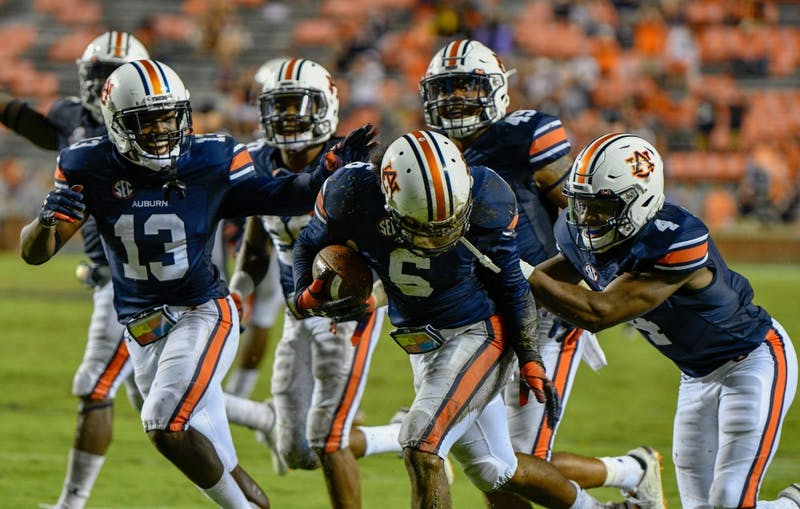 The Auburn defense celebrates during Auburn football vs. Southern Miss on Sept. 29, 2018, in Auburn, Ala.