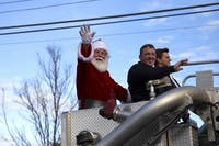 Santa waves during the Auburn Christmas Parade on Dec. 8, 2019, in Auburn, Alabama.