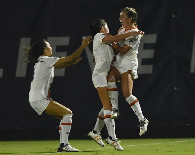 Anna Haddock, right, celebrates after kicking the winning corner kick.Auburn vs Ole Miss soccer on Tuesday, Oct. 13, 2020 in Auburn, Ala.Todd Van Emst/AU Athletics
