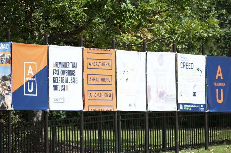 "Banners promoting Auburn University's ""A Healthier U"" COVID-19 guidelines line Thach Concourse on Sept. 23, 2020, in Auburn, Ala."