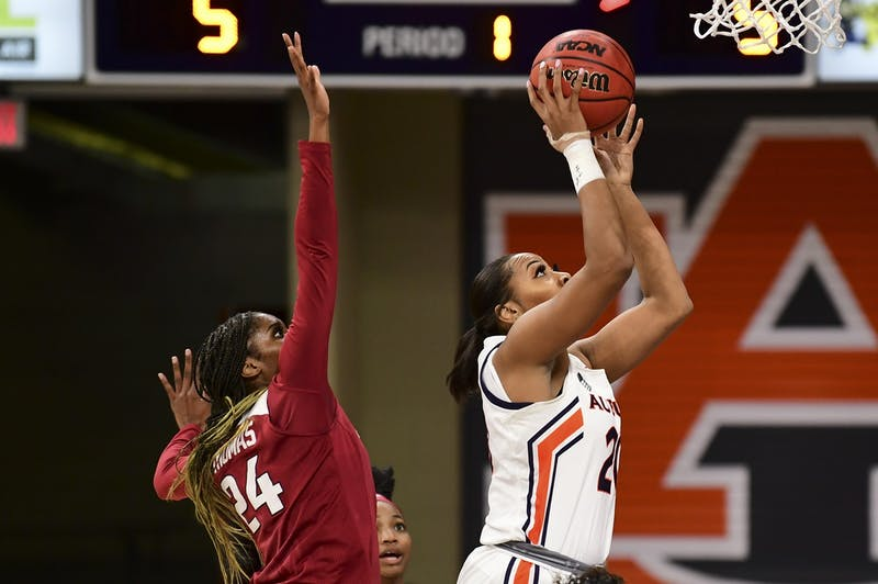 Feb 25, 2021; Auburn, AL, USA; Auburn Tigers forward Unique Thompson (20) shoots ahead of Arkansas Razorbacks forward Taylah Thomas (24) during the game between Auburn and Arkansas at Auburn Arena. Mandatory Credit: Shanna Lockwood/AU Athletics