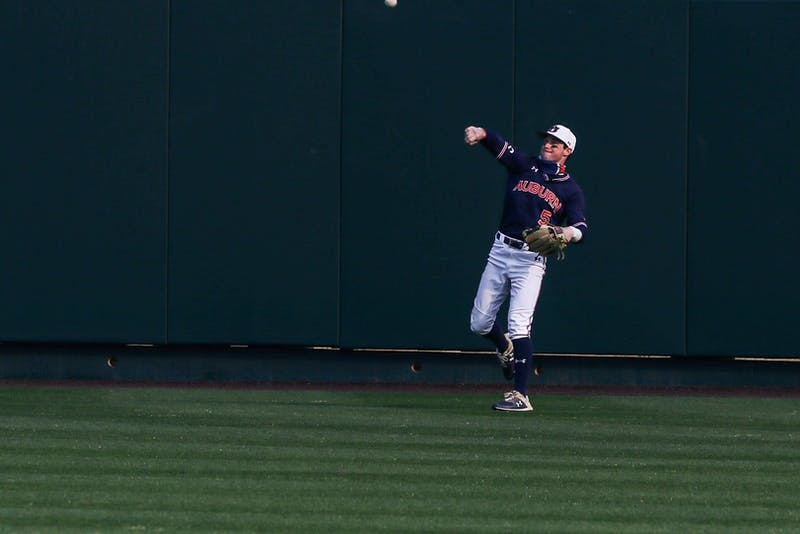 Mar 6, 2021; Auburn, AL, USA; Auburn Tigers outfielder Kason Howell (5) throws the ball after getting an out during the game between Auburn and Boston College at Auburn Arena. Mandatory Credit: Jacob Taylor/AU Athletics