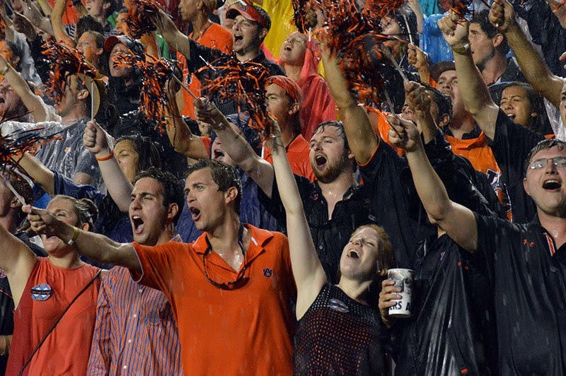 Students cheering during Auburn vs Arkansas football game on August 30, 2014. (Emily Enfinger | Assistant Photo Editor)