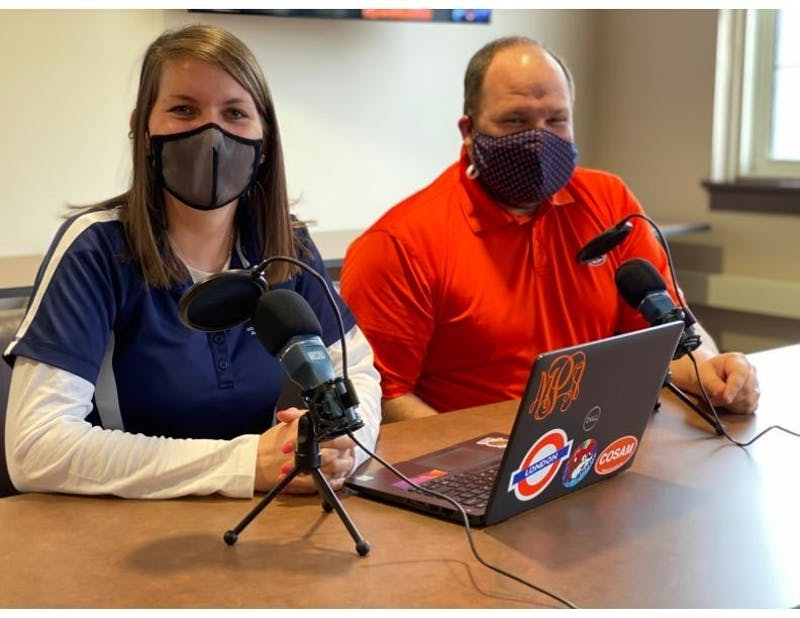 "Meredith Powell (left) and Jonathan Hallford (right) host the ""Advising 2 Bits"" podcast geared toward Auburn students in need of academic advice."