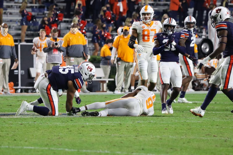 Caleb Johnson (45) grabs Tennessee's #9 by the ankles and brings him down during Auburn vs. Tennessee on Nov. 21, 2020, in Auburn, Ala.