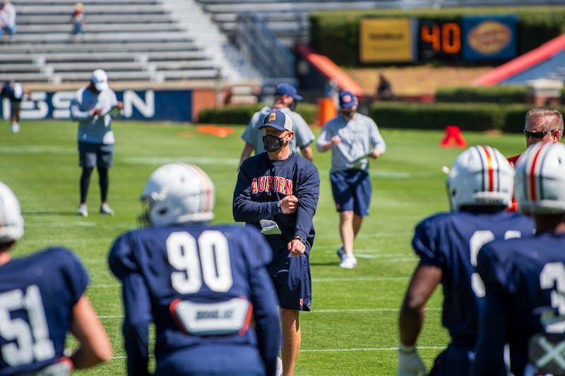 Bryan Harsin talks to his team during Auburn Footballs Open Spring Practice, on Sunday, March 21, 2021, in Auburn, Ala.