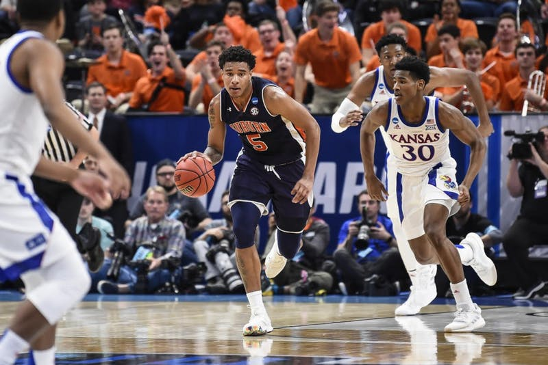 Chuma Okeke (5) dribbles the ball during Auburn men's basketball vs. Kansas on March 23, 2019, in Salt Lake City, Utah.