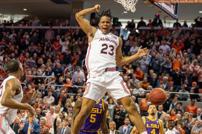 Issac Okoro (23) yells after dunking the ball during Auburn Men's Basketball vs LSU, on Saturday, Feb. 8, 2020, in Auburn, Ala.