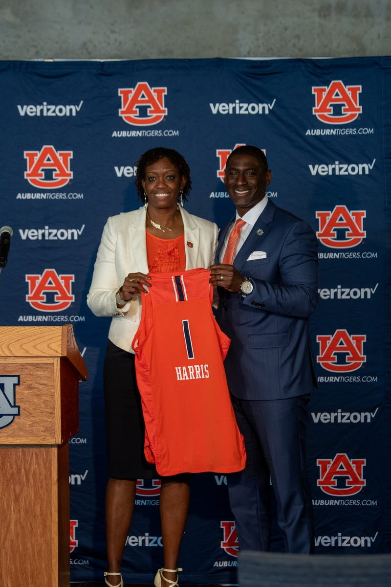 Johnnie Harris the new Auburn Women's Basketball coach stands with Allen Green at her formal introduction ceremony on Monday, April 5, 2021, in Auburn, Ala.