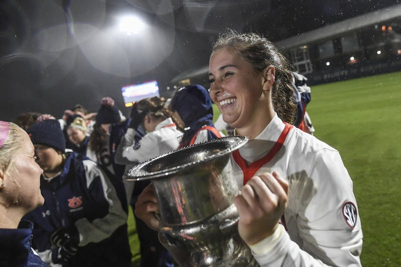 Gianna Montini (29) holds the Iron Bowl trophy after Auburn soccer vs Alabama on Thursday, October 25, 2018, in Auburn, Ala.