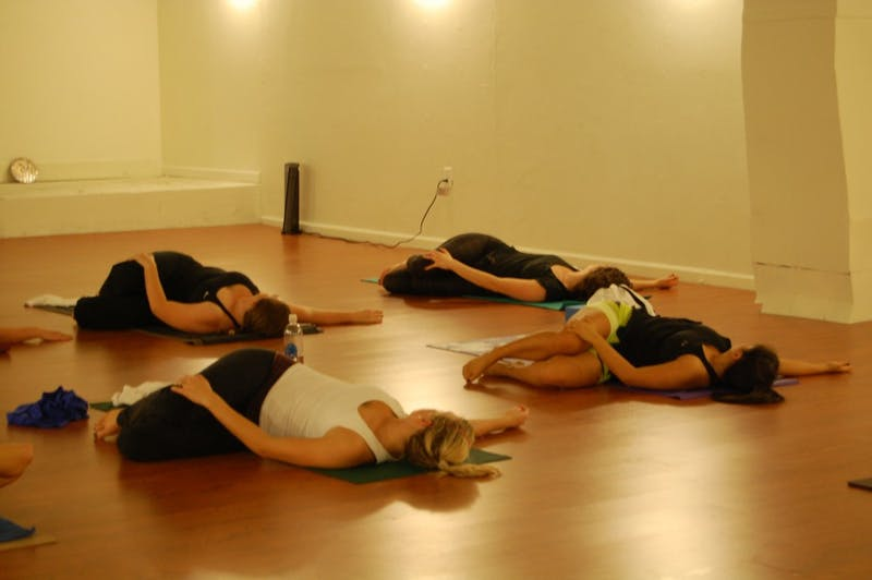 Yogafly members begin their morning class with tranquil meditation.