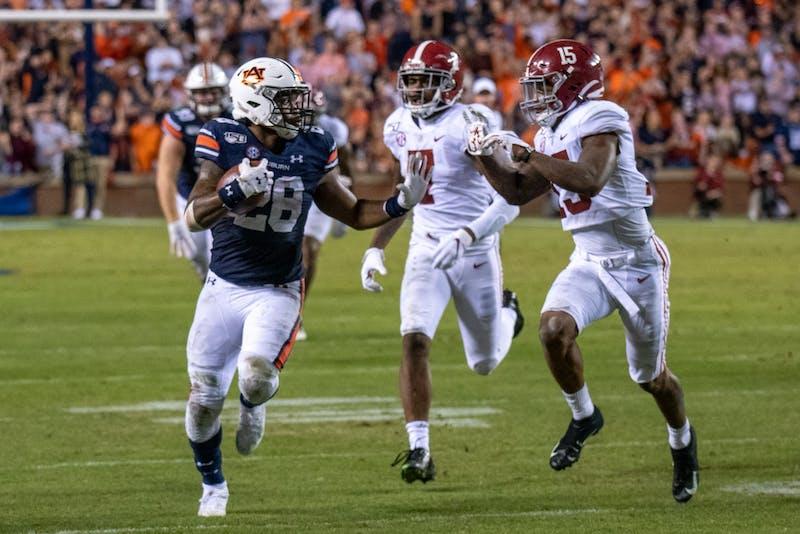 JaTarvious Whitlow (28) runs the ball during Auburn Football vs. Alabama, on Saturday, Nov. 30, 2019, in Auburn, Ala.