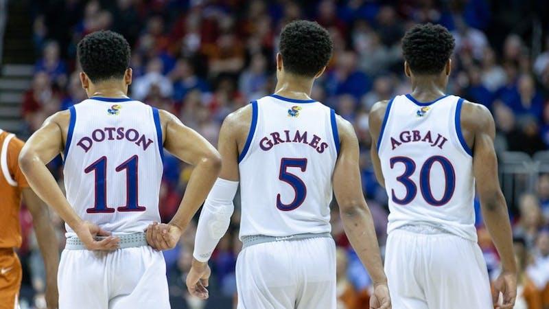 Kansas' Devon Dotson (11), Quentin Grimes (5) and Ochai Agbaji (30) via KUAthletics.com.
