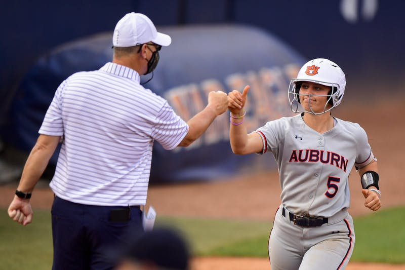 Apr 13, 2021; Auburn, AL, USA; Auburn Tigers Lindsey Garcia (5) greets Mickey Dean after she hits a home run during the game between Auburn and Alabama State at Jane B. Moore Field. Mandatory Credit: Shanna Lockwood/AU Athletics