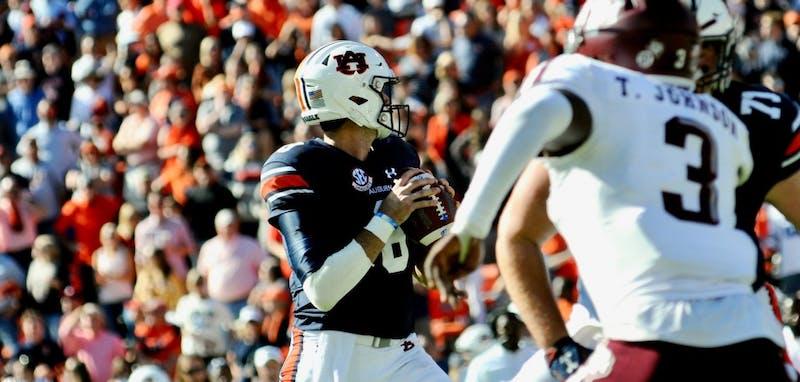 Jarrett Stidham (8) looks to make a pass during the second half of Auburn Football vs. Texas A&M on Saturday, Nov. 3, 2018, in Auburn, Ala.