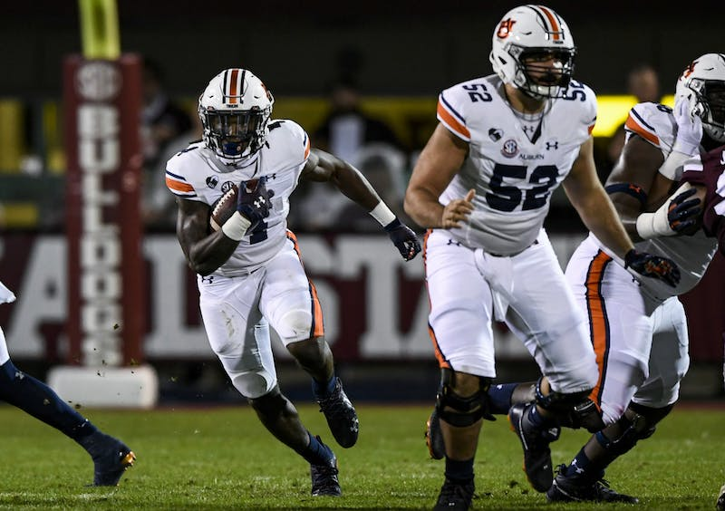 Tank Bigsby (4) starts to run during the game between Auburn and Mississippi State at Davis Wade Stadium on Dec 12, 2020; Starkville, Mississippi, USA. Photo via: Todd Van Emst/AU Athletics