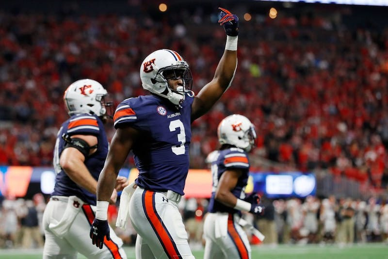 Nate Craig-Myers #3 of the Auburn Tigers celebrates a touchdown during the first half against the Georgia Bulldogs in the SEC Championship at Mercedes-Benz Stadium on December 2, 2017 in Atlanta, Georgia.