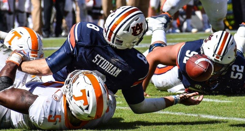 Jarrett Stidham (8) fumbles the ball during Auburn football vs. Tennessee on Oct. 13, 2018, in Auburn, Ala.