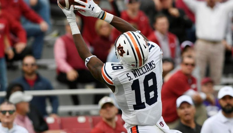 Seth Williams (18) hauls in a touchdown during Auburn at Arkansas on Oct. 19, 2019, in Fayetteville, Ark.
