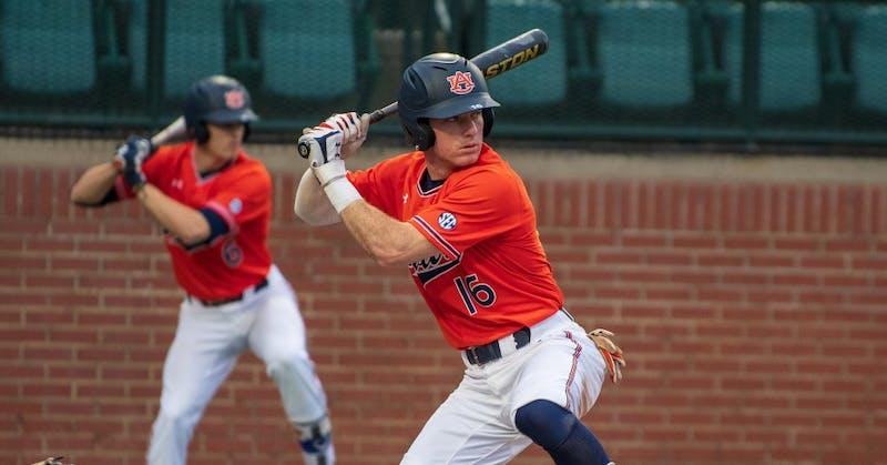 Kason Howell (16) winds up to swing at the ball during Auburn Baseball vs. Cincinnati on Saturday, March. 2, 2019, in Auburn, Ala.