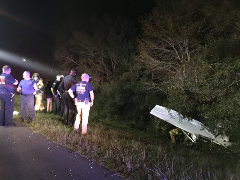 First responders on the site of a plane crash off of I-85 on Oct. 16, 2018.