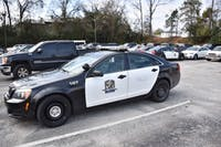 An Auburn Police Department car sits parked outside of the public safety department building on Friday, Feb. 9, 2018, in Auburn, Ala.