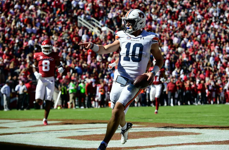 Oct 16, 2021; Fayetteville, AR, USA; Bo Nix (10) touchdown between Auburn and Arkansas at Donald W. Reynolds Razorback Stadium. Mandatory Credit: Todd Van Emst/AU Athletics