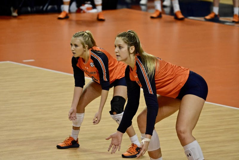 Katie Persons (14) and Tatum Shipes (21) prepare to hit during the Auburn vs. Alabama game on Wednesday, Oct. 2, 2019, in Auburn, Ala.