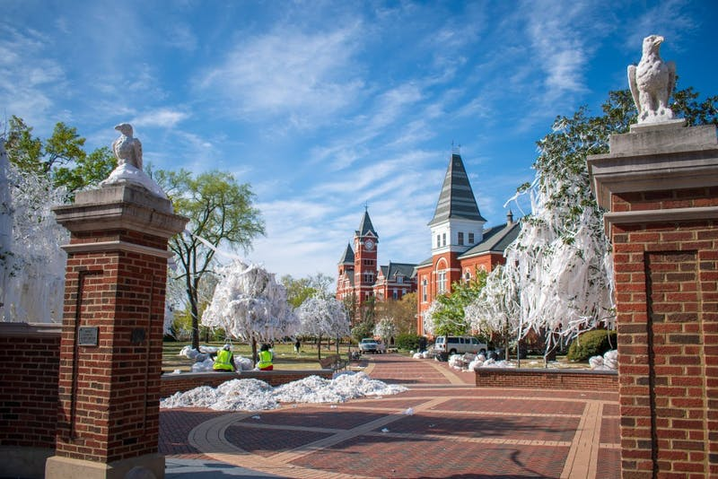 The trees at Toomer's Corner sit covered in toilet paper following Auburn's Elite Eight win over Kentucky, on Monday, April 1, 2019, in Auburn, Ala.