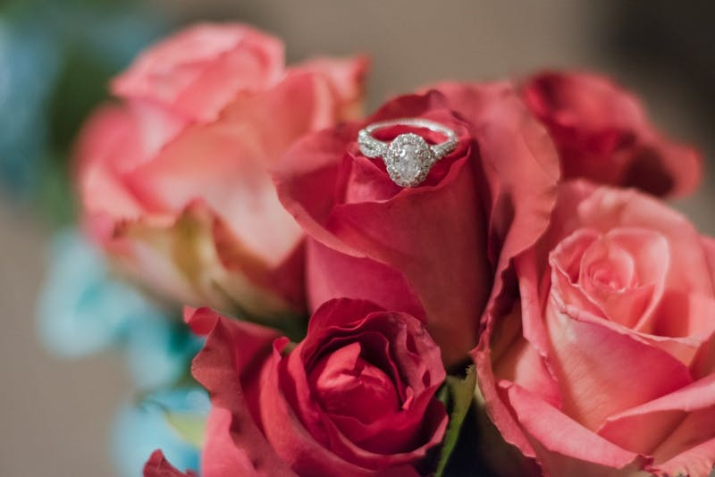 A Verragio diamond engagement ring sits on top of a vase of roses on Monday, Feb. 5, 2018, in Auburn, Ala.