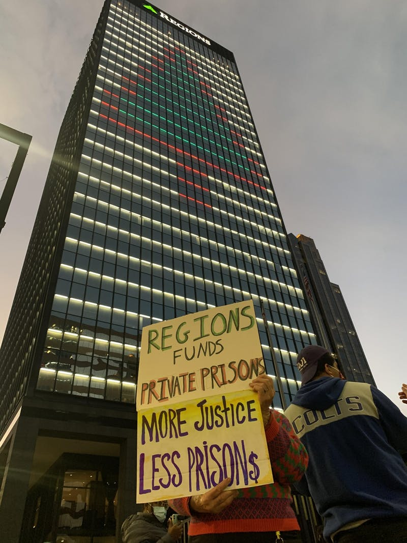 Students protest outside of Regions Bank in Birmingham, Ala. on Dec. 28, 2020, for the bank's investment in CoreCivic, a private prison development company.