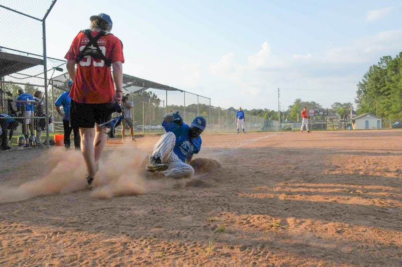 An ABL player slides onto base.