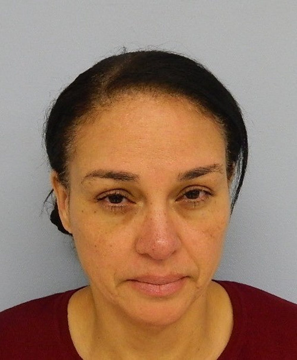 Auburn woman charged with theft of more than $50,000