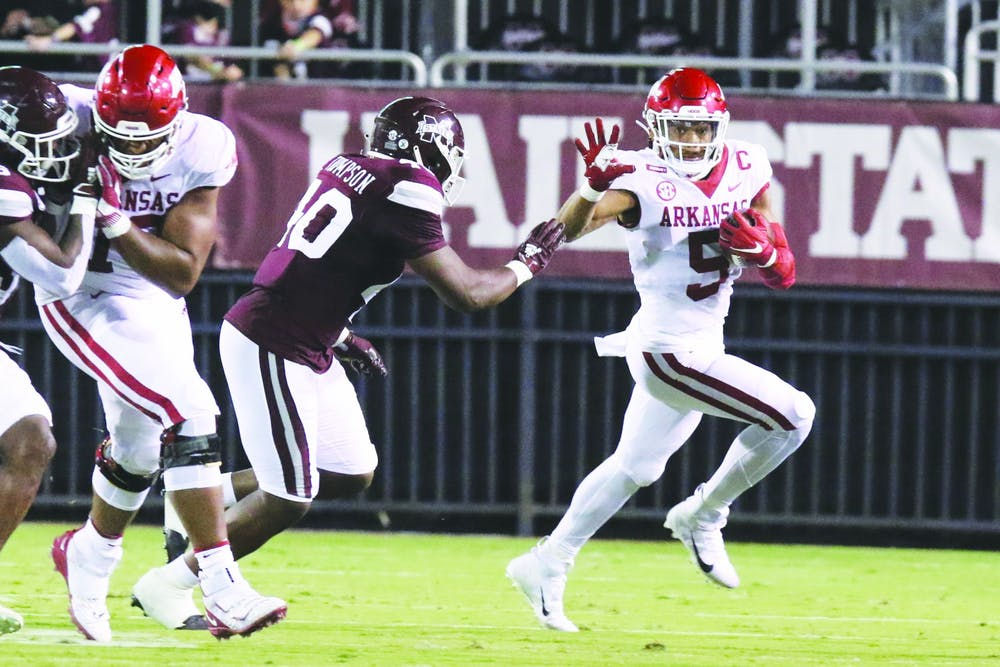 Behind Enemy Bylines - The Arkansas Traveler