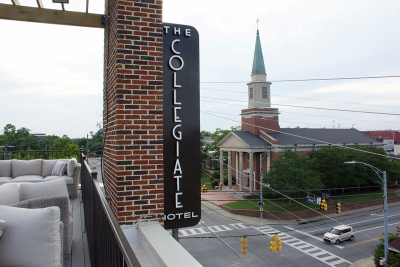 The sign for The Collegiate Hotel at Auburn from the rooftop garden Friday, June 15, 2018 in Auburn, Ala.