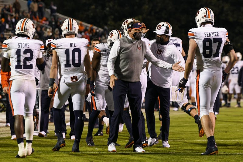 Oct 3, 2020; Starkville, Mississippi, USA; Coach Gus Malzahn with offense during the game between Auburn and Mississippi State at Davis Wade Stadium. Mandatory Credit: Todd Van Emst/AU Athletics