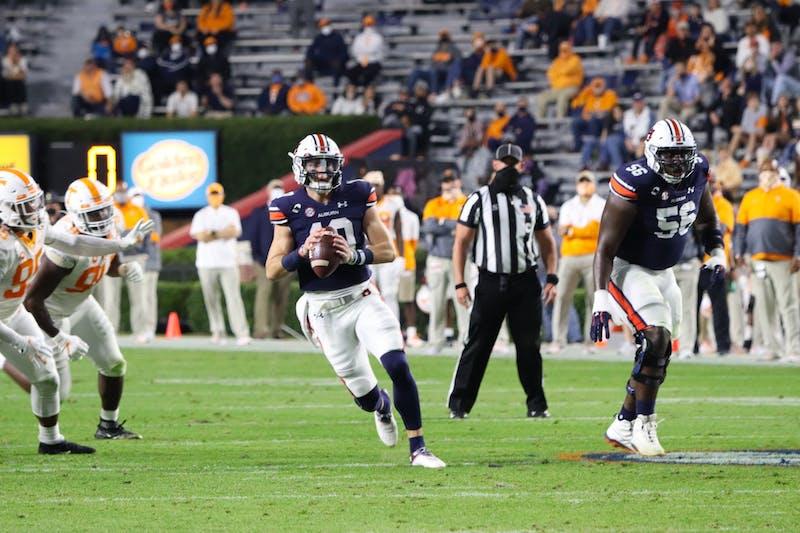 Bo Nix (10) runs the ball and then prepares to throw it during Auburn vs. Tennessee on Nov. 21, 2020, in Auburn, Ala.