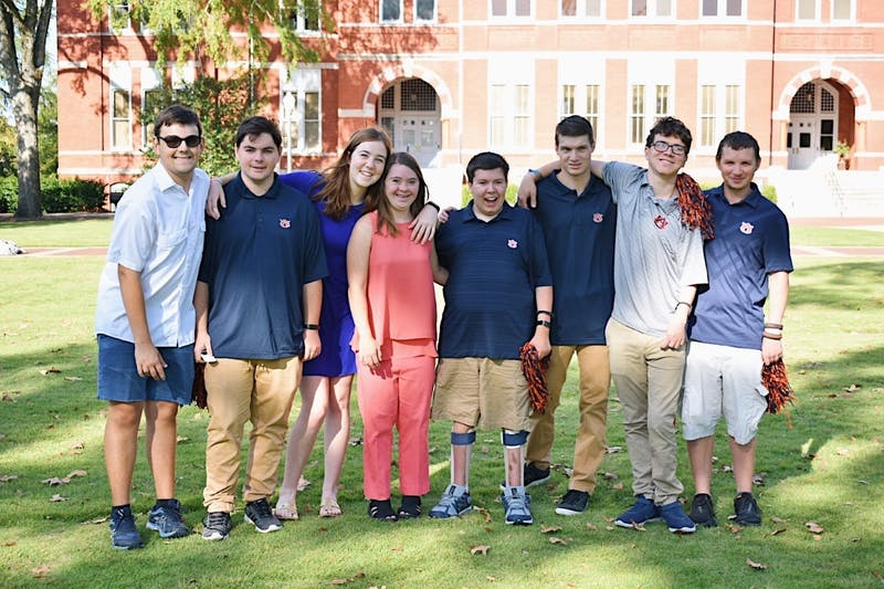 EAGLES program students pose for a photo in front of Samford Hall in Auburn, Ala.