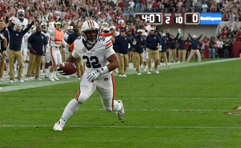 Malik Miller (32) catches a touchdown during Auburn football vs. Alabama on Nov. 24, 2018, in Tuscaloosa, Ala.