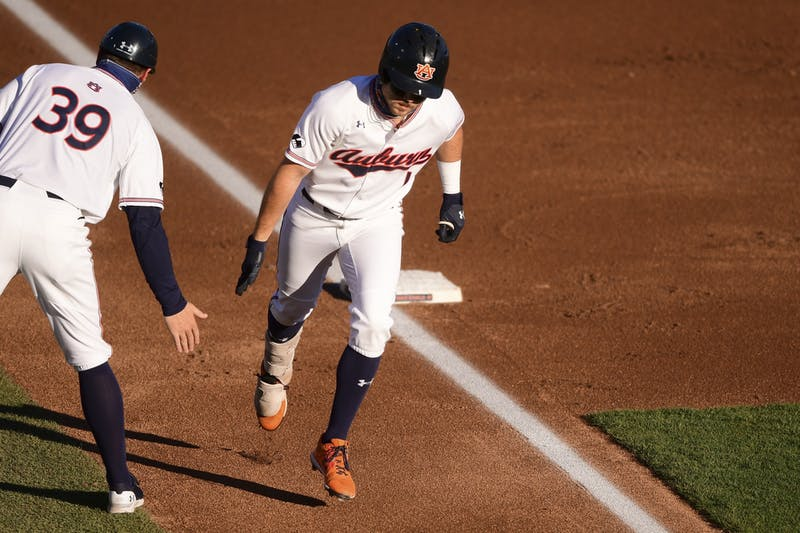Feb 23, 2021; Auburn, AL, USA; Auburn Tigers outfielder Judd Ward (1) rounds third base on his way to home to score a run during the game between Auburn and Alabama A&M at Plainsman Park. Mandatory Credit: Shanna Lockwood/AU Athletics