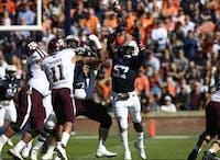 Deshaun Davis (57) leaps for the ball during Auburn football vs. Texas A&M on Nov. 3, 2018, in Auburn, Ala.