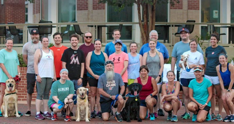 Dr. Doug Hankes (bottom row, second from left) after a run with parents at a 2019 Camp War Eagle session.