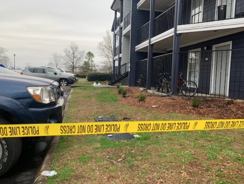 Crime tape surrounds a building in the Evergreen apartment complex on Feb. 16, 2020.
